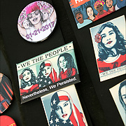 """Humorous political Anti President Trump Buttons:  """"We the People"""", """"Here to Stay"""", """"We Won't Go Back"""", """"I Stand with Refugees"""", for sale at Demonstration Rally in Washington Square Park."""
