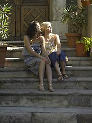 Jul. 08, 2008 - Female friends sitting on step. Model Released (MR) (Credit Image: © Cultura/ZUMAPRESS.com)