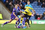 Shrewsbury Town midfielder Oliver Norburn (8) slides in to tackle Oxford United midfielder Tarique Fosu-Henry  (11) during the EFL Sky Bet League 1 match between Oxford United and Shrewsbury Town at the Kassam Stadium, Oxford, England on 7 December 2019.