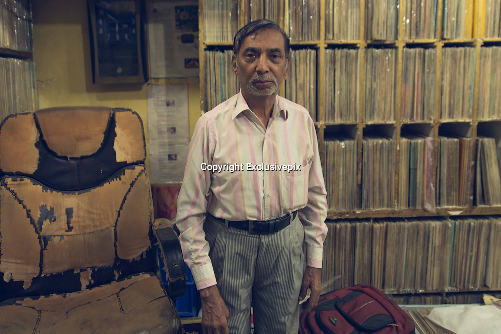 New Delhi's only vinyl record store<br /> <br /> Founded in 1930 in Lahore, Pakistan, New Gramophone House is now the last remaining record shop in Delhi. Relocated to the Indian capital in 1947 following the Indian-Pakistan partition, and nestled above a shoe shop in Delhi's frenetic Chandni Chowk district, the small room houses over one LAKH of records. Once a record shop amongst hundreds of others in Delhi, New Gramophone House now remains the only surviving outlet for vinyl records and has become an institution amongst locals and international collectors alike. <br /> <br /> The current manager, Anuj Rajpal is the son of the previous manager of the shop Ramesh Rajpal who remains ever present in the shop. Ramesh's father was the original founder; New Gramophone House is very much a family affair. <br /> <br /> A tardis of music and a haven for lovers of a bygone musical format, the stacks upon stacks of records make it difficult to know where to begin. With a recording by Lata Mangeshkar on my phone, I played it to the shop assistant and so began my foray in to the depths of New Gramophone House's collection. From religious recordings in Urdu, to Bollywood B Movie soundtracks via snake charmer recordings, this was unlike any record shop experience I've experienced. Beautiful record artwork, stacks of 7 inches, tens of gramophones and an ambivalent manager Anuj Rajpal, reminiscent of Jack Black in High Fidelity, made the experience one that will not be soon forgotten. <br /> <br /> With sales of vinyl increasing for the first time in two decades, New Gramophone House has seen its popularity grow in the last couple of years attaining somewhat of a cult following, thanks to a new generation of music lovers with a keen sense of nostalgia and a love of music from yesteryear.<br /> ©Tom D Morgan/Exclusivepix
