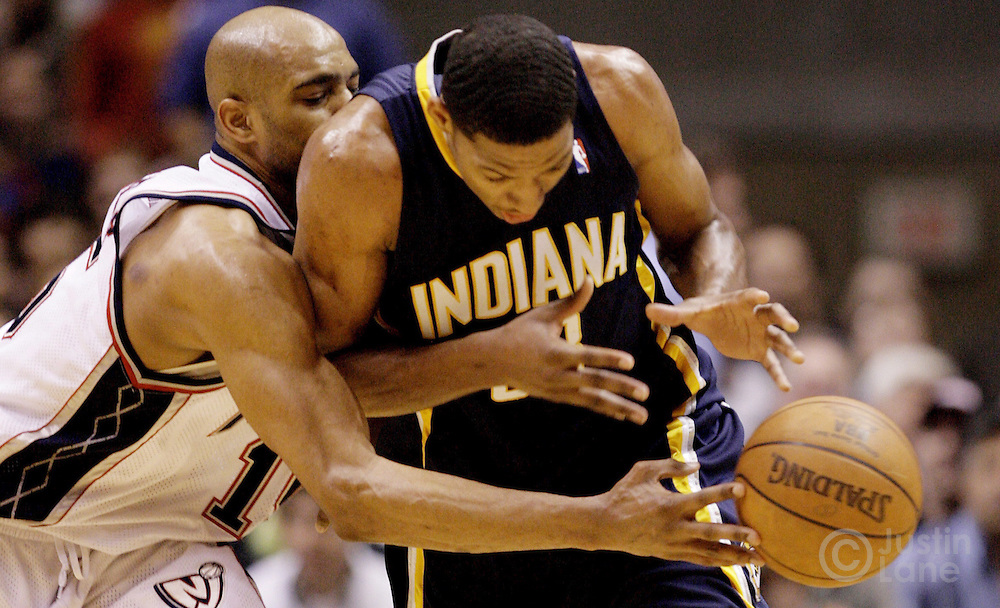 epa00698527 The Nets' Vince Carter (L) pokes the ball away from the Pacers' Danny Granger (R) during the second quarter of game two of the round one playoff match up between the Indiana Pacers and the New Jersey Nets at Continental Airlines Arena, Tuesday, 25 April 2006 in East Rutherford, New Jersey.  EPA/Justin Lane