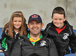 Kilmeena supporters Siofra and Charlie Hughes with their dad Damien pictured a the junior championship play off match in Islandeady on sunday.<br /> Pic Conor McKeown