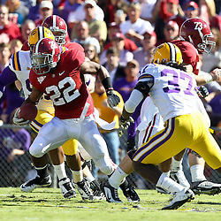 November 6, 2010; Baton Rouge, LA, USA; Alabama Crimson Tide running back Mark Ingram (22) is pursued by LSU Tigers safety Karnell Hatcher (37) and defensive tackle Lazarius Levingston (95) during the first half at Tiger Stadium.  Mandatory Credit: Derick E. Hingle