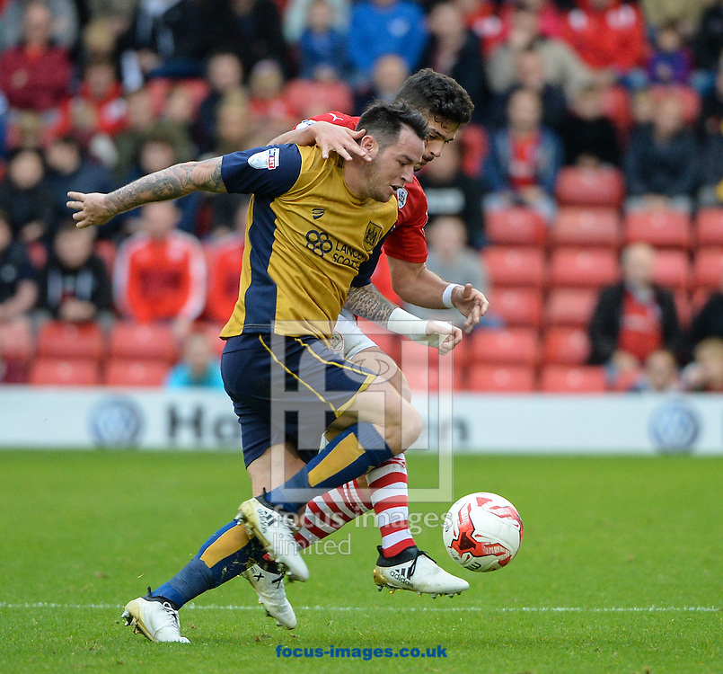 Sam Morsy of Barnsley and Lee Tomlin of Bristol City during the Sky Bet Championship match at Oakwell, Barnsley<br /> Picture by Richard Land/Focus Images Ltd +44 7713 507003<br /> 29/10/2016
