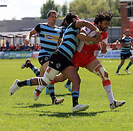 Ade Gardner (right) of Hull Kingston Rovers is tackled by Denny Solomona of London Broncos during the First Utility Super League match at the KC Lightstream Stadium, Kingston upon Hull<br /> Picture by Richard Gould/Focus Images Ltd +44 7855 403186<br /> 25/05/2014