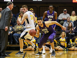 Feb 12, 2018; Morgantown, WV, USA; TCU Horned Frogs forward Ahmed Hamdy-Mohamed (23) dribbles after a steal during the first half against the West Virginia Mountaineers at WVU Coliseum. Mandatory Credit: Ben Queen-USA TODAY Sports