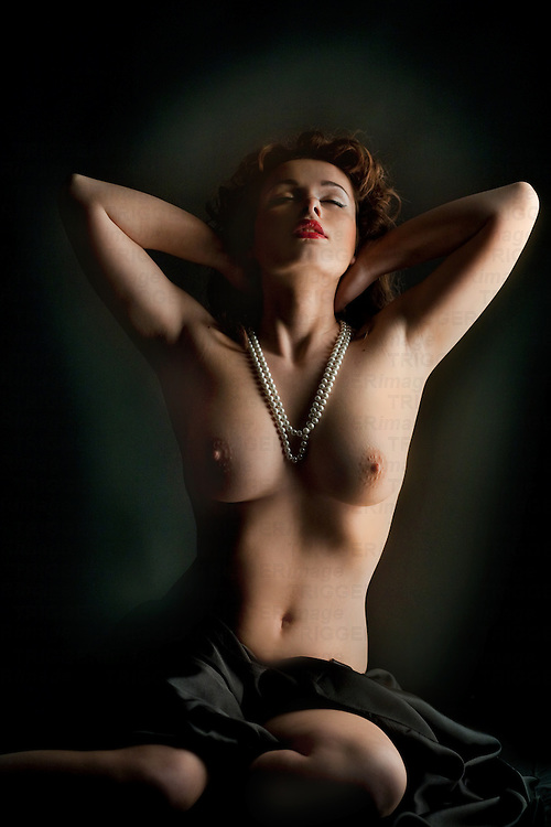 vintage frontal nude of brunette girl with pearls