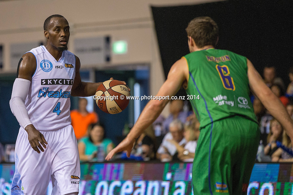 Breakers` Cedric Jackson is challenged by Crocodiles' Mitch Norton in the game between SkyCity Breakers v Townsville Crocodiles. 2014/15 ANBL Basketball Season. North Shore Events Centre, Auckland, New Zealand, Friday, December 19, 2014. Photo: David Rowland/Photosport