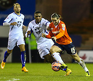 Luke Rooney of Luton Town (right) and Kelvin Etuhu of Bury (2nd right) during the The FA Cup match at Kenilworth Road, Luton<br /> Picture by David Horn/Focus Images Ltd +44 7545 970036<br /> 16/12/2014