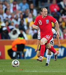 Wayne Rooney in action during the 2010 World Cup Soccer match between England and Germany in a group 16 match played at the Freestate Stadium in Bloemfontein South Africa on 27 June 2010.