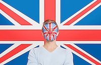 Portrait of young man in white t-shirt with face painting against British flag