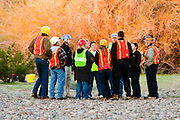 16 MARCH 2010 -- BUCKEYE, AZ: Colorado's rescuers have a safety briefing the Gila River bed near Buckeye Tuesday morning. Colorado has spent the last several days marooned on a sandbar in the middle of the river after he and his owners were nearly swept downstream during a trail ride.   PHOTO BY JACK KURTZ