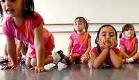 JEROME A. POLLOS/Press..Riley Walker, left, McKayli Mitchell, Mikelli Villasenor and Emily Damschen wait for the conclusion of their dance recital practice on Wednesday at Le Danse Studio in Coeur d'Alene. The girls were honing their dance steps for a free performance this Saturday at 5 p.m. at the Rotary Bandshell in City Park.