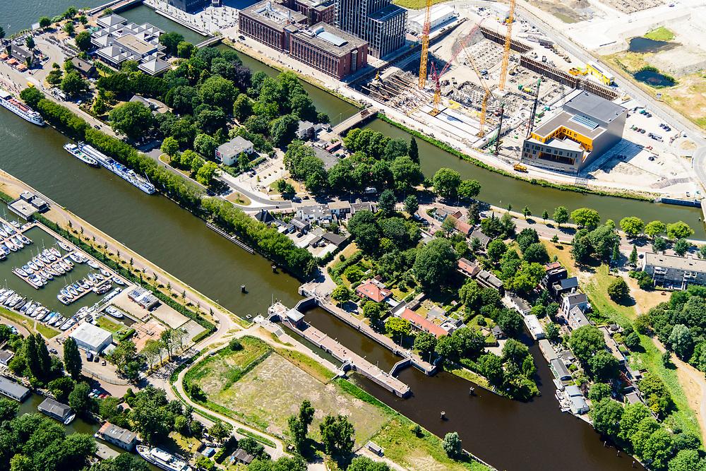 Nederland, Noord-Holland, Amsterdam-Noord, 29-06-2018; Buiksloterham,  Overhoeks, voormalig Shell Research-terrein. Huisvest nu onder andere filmmuseum EYE (EYE Film Instituut Nederland), de toren Overhoeks, de A'DAM Lookout toren, Tolhuistuin, Oeverpark. Onder in beeld Noordhollandsch kanaal ket Willem I-sluis.<br /> Overhoeks, a new city district on the IJ bank in Amsterdam-North.<br /> <br /> luchtfoto (toeslag op standard tarieven);<br /> aerial photo (additional fee required);<br /> copyright foto/photo Siebe Swart