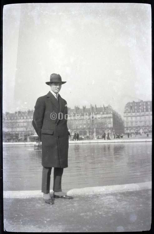 male person standing in public park Paris 1900s