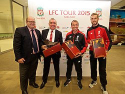ADELAIDE, AUSTRALIA - Saturday, July 18, 2015: Liverpool's captain Jordan Henderson and manager Brendan Rodgers are presented with RM Williams boots by Rodney Harrex, CEO of South Australia Tourism Commission at a press conference at Adelaide Airport ahead of a preseason friendly match against Adelaide United on day six of the club's preseason tour. (Pic by David Rawcliffe/Propaganda)