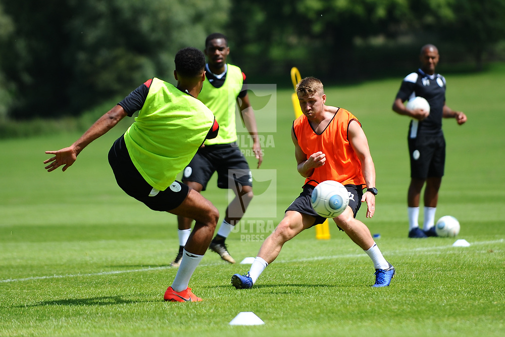 Darryl Knights closes down Marcus Dinanga as AFC Telford United return to pre-season training at Lilleshall National Sports Centre on Saturday, June 29, 2019.<br /> <br /> Free for editorial use only<br /> Picture credit: Mike Sheridan/Ultrapress<br /> <br /> MS201920-003