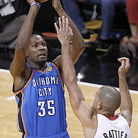 17 June 2012: Oklahoma City Thunder small forward Kevin Durant (35) takes a jumpshot over Miami Heat small forward Shane Battier (31) during the Miami Heat 91-85 victory over the Oklahoma City Thunder, in Game 3 of the 2012 NBA Finals, at the AmericanAirlinesArena, Miami, Florida, USA.