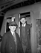 21/04/1960<br /> 04/21/1960<br /> 21 April 1960<br /> Cork - Dublin bomb scare train arrives. Drivers Patrick Dorney (left), Dillons Cross, Cork and John O'Neill, Kilbarrick, Cork, who brought the 3.15pm train from Cork into Kingsbridge Station (Heuston Station), Dublin, at 11.35pm after a bomb scare delay at Kilmallock, Co. Limerick.