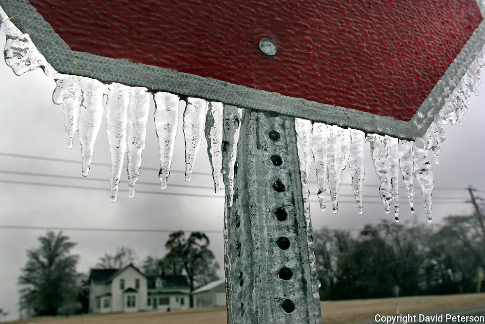 Icicles  hang from a stop sign in Pleasant Hill, Iowa, after freezing rain preceded several inches of snow making for a dangerous weekend of travel in central Iowa.  The midwest has experienced severe winters in both 2007-2008, causing many traffic accidents and some deaths.