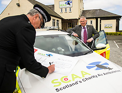Pictured: Chief Constable Phil Gormley and Scottish Police Benevolent Fund seretary David Hamilton. <br /> The Scottish Police Benevolent Fund has donated £30,000 to help fund Scotland's Charity Air Ambulance (SCAA). Police Scotland Chief Constable Phil Gormley and Scottish Police Benevolent Fund secretary David Hamilton visited SCAA in Perth to thank them for their work. <br /> <br /> Ger Harley | EEm 16 May April 2016