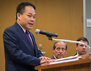 Houston ISD trustee Greg Meyers listens to comments by Director General Louis M. Huang of the Taipei Economic and Cultural Office in Houston during a partnership signing ceremony between HISD and Taipei City, December 17, 2015.