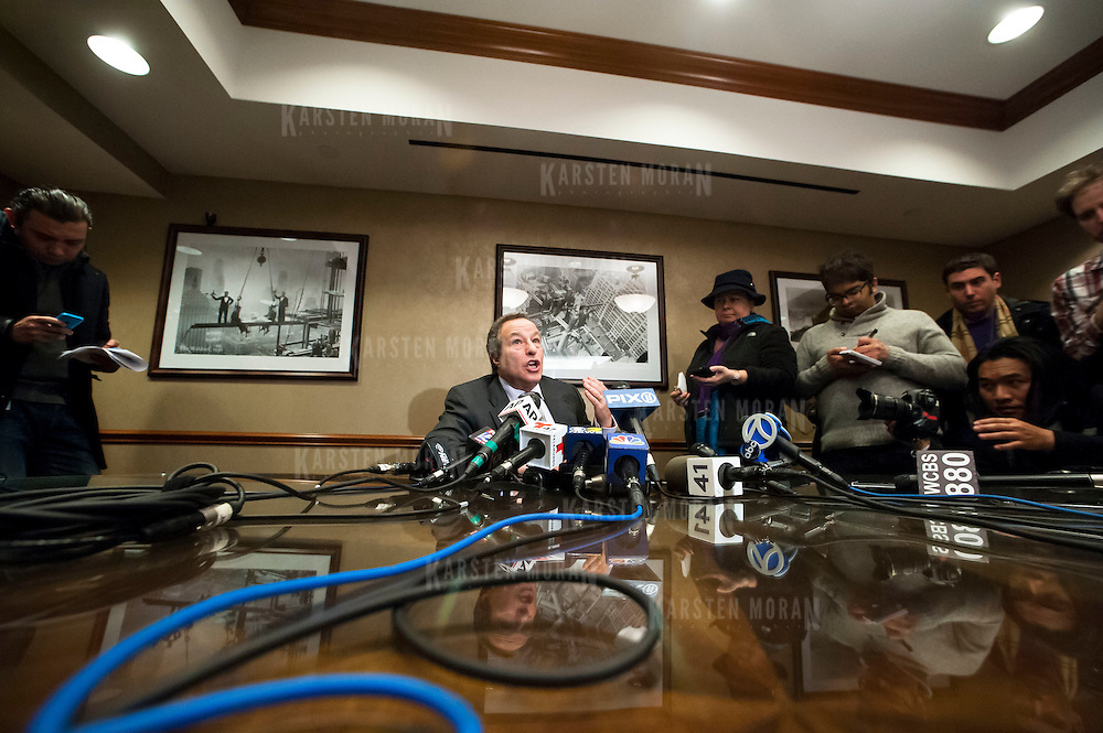January 21, 2014 - New York, NY : <br /> David H. Perecman, attorney for the family of Avonte Oquendo, held a press conference at his office at 250 West 57th Street in Manhattan on Tuesday afternoon to announce that the remains <br /> discovered along the East River in Queens last week were matched to the missing autistic teenager. Pictured here, Mr. Perecman, seated at center, speaks with reporters.<br /> CREDIT: Karsten Moran for The New York Times