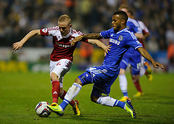 Swindon Forward Alex Pritchard (ENG) is tackled by Chelsea Forward Andre Schurrle (GER) during the second half of the match - Photo mandatory by-line: Rogan Thomson/JMP - Tel: 07966 386802 - 24/09/2013 - SPORT - FOOTBALL - The County Ground - Swindon Town v Chelsea - Capital One Cup Round 3.