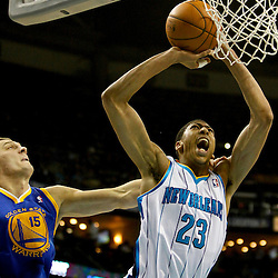 Jan 19, 2013; New Orleans, LA, USA; Golden State Warriors power forward Andris Biedrins (15) fouls New Orleans Hornets power forward Anthony Davis (23) on a shot during  the first quarter of a game at the New Orleans Arena. Mandatory Credit: Derick E. Hingle-USA TODAY Sports