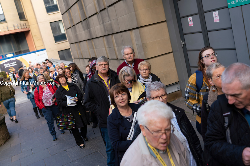 Edinburgh, Scotland, UK. 27 April, 2019. SNP ( Scottish National Party) Spring Conference takes place at the EICC ( Edinburgh International Conference Centre) in Edinburgh.  Delegates queuing to enter the conference.
