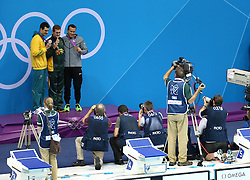 29th July 2012 - London 2012 Olympic Games - Swimming - Men's 100m Breaststroke Final - Cameron van de Burgh (RSA) poses with his gold medal (C) - Photo: Simon Stacpoole / Offside./SPORTZPICS