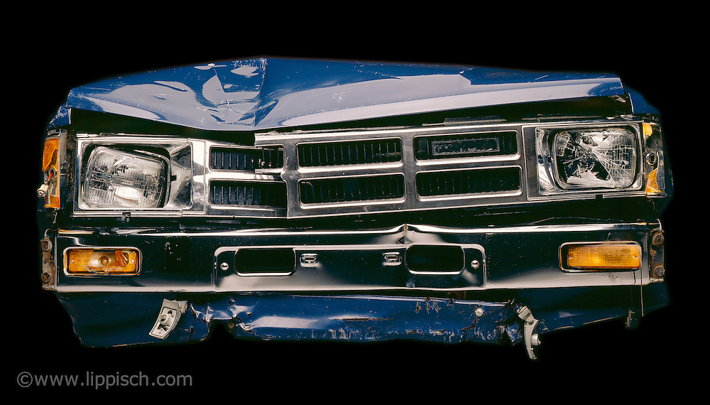 Created in the studio, this truck front end was carefully dented and broken to fit the client's needs.