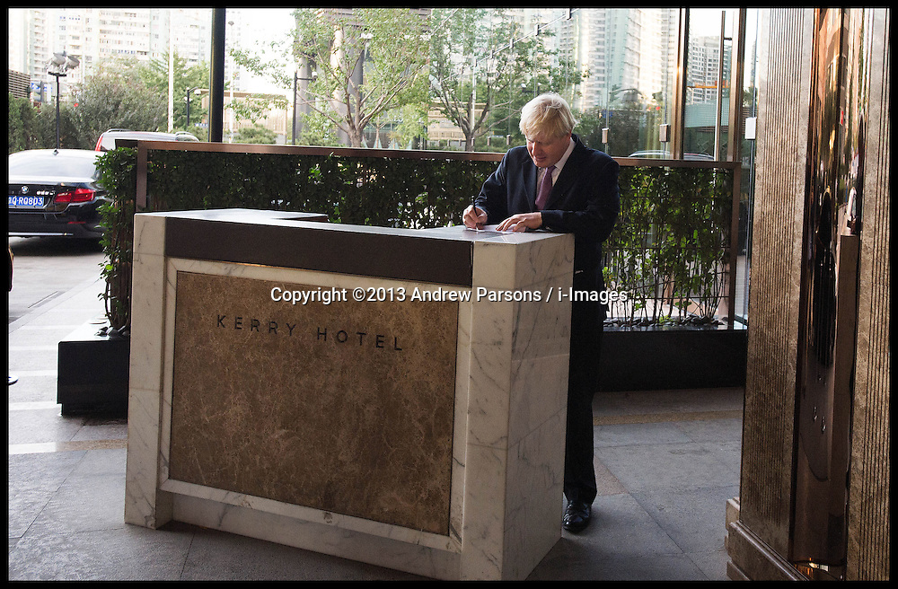 The London Mayor Boris Johnson writing his speech on the hotel's porter's desk just before  for the London Luxury Quarter event in Beijing, China, on Day 2 of The Mayor's 6 day trip to China, Monday, 14th October 2013. Picture by Andrew Parsons / i-Images