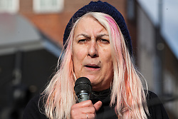 London, UK. 9th February, 2019. Janie Mac of Refugee Community Kitchen addresses activists from Extinction Rebellion blocking Kingsland Road in Dalston as part of a 'Saturday street party' intended as a means of engagement around climate change and environmental issues with the local community.