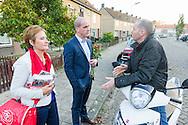 Nederland, Den Bosch, 20141101.<br /> Diederik Samsom, fractievoorzitter van de PvdA en Lisette van der Swaluw fractievoorzitter PvdA Den Bosch gaan de buurt in. Canvassen in Den Bosch <br /> In gesprek met een man op een scooter die Samson aanspreekt op straat. Huis aan huis<br /> In de gemeente Den Bosch staan verkiezingsborden. Die zijn bedoeld voor de gemeenteraadsverkiezingen in Den Bosch, op woensdag 19 november. <br /> Vanwege de gemeentelijke herindeling van Maasdonk zijn de verkiezingen in Den Bosch pas op 19 november. Nuland en Vinkel komen bij Den Bosch, Geffen bij Oss. In Nuland en Vinkel zijn de verkiezingsborden al geplaatst. In totaal verschijnen 42 van deze grote borden in de gemeente. <br /> <br /> Netherlands, Den Bosch, 20141101.<br /> The city of Den Bosch are election signs. Intended for the municipal elections in Den Bosch, on Wednesday 19th November. <br /> Because of the municipal reorganization of Maasdonk the elections in Den Bosch until November 19th. Nuland and Leek come Den Bosch, Geffen at Oss. Nuland Leek and his election signs already posted. A total of 42 of these appear large signs in the municipality.