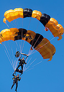 07-18418.Photo by Kevin Riddell.Members of the Army's Golden Knights parachute team lands in Peden Stadium before the game against Kent State on Saturday, September 29, 2007.
