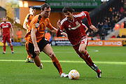 Middlesbrough striker Diego Fabbrini skips past Wolverhampton Wanderers midfielder Kevin McDonald during the Sky Bet Championship match between Wolverhampton Wanderers and Middlesbrough at Molineux, Wolverhampton, England on 24 October 2015. Photo by Alan Franklin.