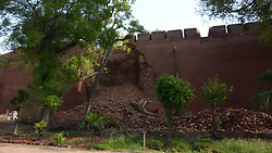 July 4, 2018 - Lahore, Punjab, Pakistan - A view Wall of Mughal era Lahore Fort collapsed after the intense monsoon rains in Lahore on July 04, 2018. The ongoing pre-monsoon rain spell has once again hit the city death toll in over the past two days has risen to 15 with more than 50 people reportedly being injured in rain-related incidents. Choked drains, broken roads and faulty wiring have led to enormous damage and loss of life and property. The Met Office has said that due to high pressure monsoon currents penetrating in the country, the Punjab capital, as well as other cities. (Credit Image: © Rana Sajid Hussain/Pacific Press via ZUMA Wire)