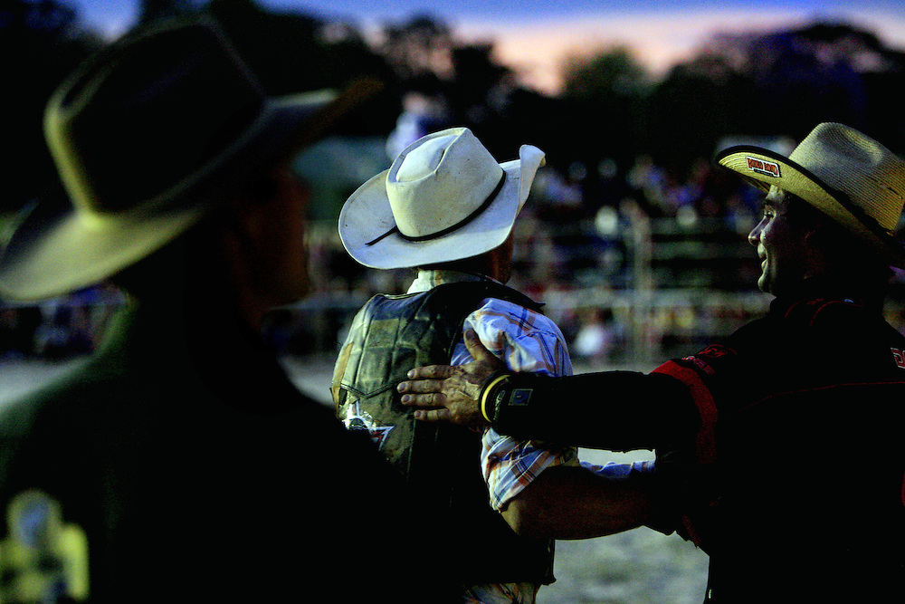 A bullrider is congratulated after his ride during the National Bullriding Championships at Penrith Paceway , Sydney , Australia.