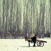 Uyghur man arrived at a livestock market<br />  in Kashgar, Xinjiang, on   February. 21, 2010. Photographer: Bernardo De Niz