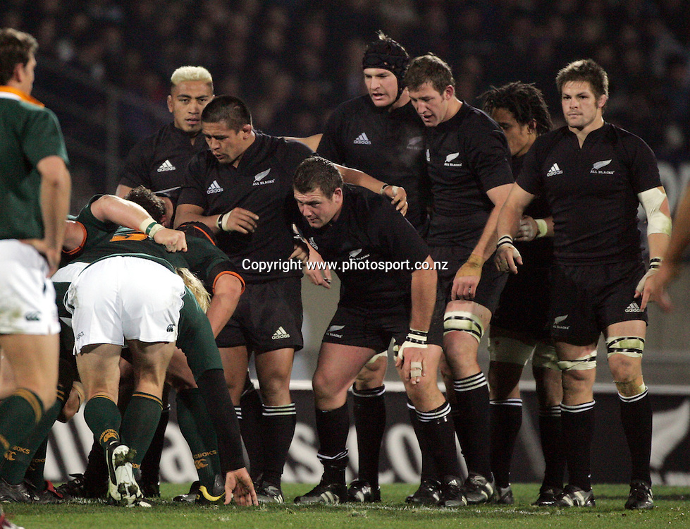 The All Black scrum prepare to pack down during the Tri Nations rugby test match between the All Blacks and South Africa at Carisbrook in Dunedin, New Zealand on Saturday 27 August, 2005. The All Blacks won 31-27. Photo: Andrew Cornaga/PHOTOSPORT<br />