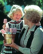 A blond girl and her grandmother in a food product advertising campaign for Mountain Fuel, Utah