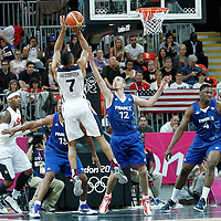 29 July 2012: USA Russell Westbrook takes a jumpshot over Nando De Colo of France during the 98-71 Team USA victory over Team France, during the men's basketball preliminary, at the Basketball Arena, in London, Great Britain.