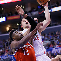 24 March 2014: Los Angeles Clippers forward Blake Griffin (32) goes for the layup against Milwaukee Bucks forward Jeff Adrien (12) during the Los Angeles Clippers 106-98 victory over the Milwaukee Bucks at the Staples Center, Los Angeles, California, USA.
