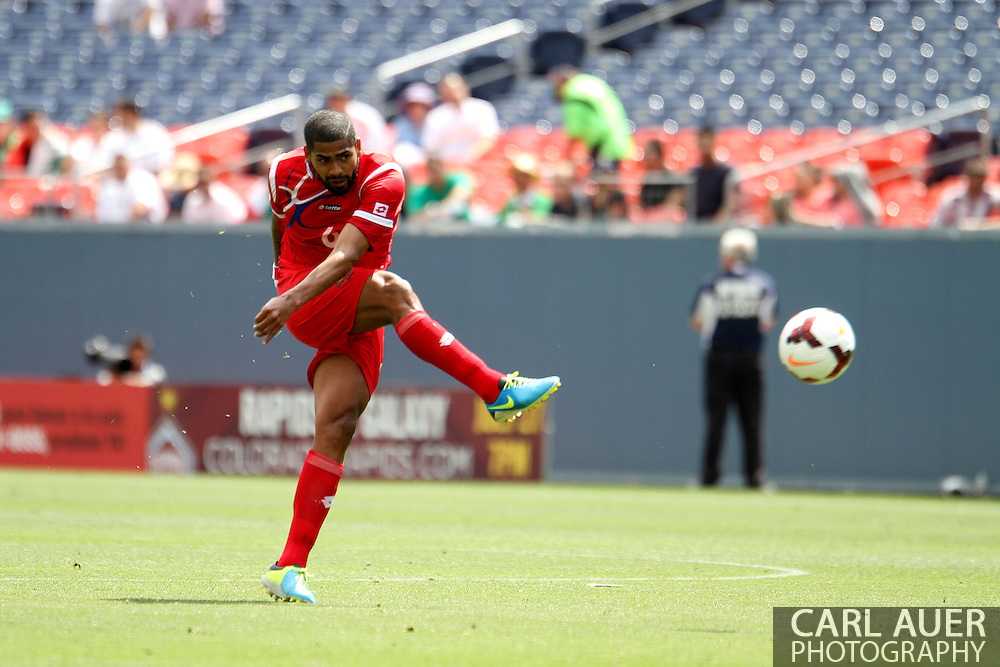 July 14 2013:  Panama Midfield Gabriel Gomez (6) launches a shot towards the goal during the second half of the CONCACAF Gold Cup soccer match between Panama and Canada at Sports Authority Field in Denver, CO. USA.