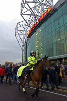 Photo. Jed Wee.<br /> Manchester United v Charlton Atheltic, FA Barclaycard Premiership, 20/04/2004.<br /> Security fears amidst terrorism raids in Manchester sees stepped up security at Old Trafford, as a mounted policewoman patrols in front of the Manchester United home ground.