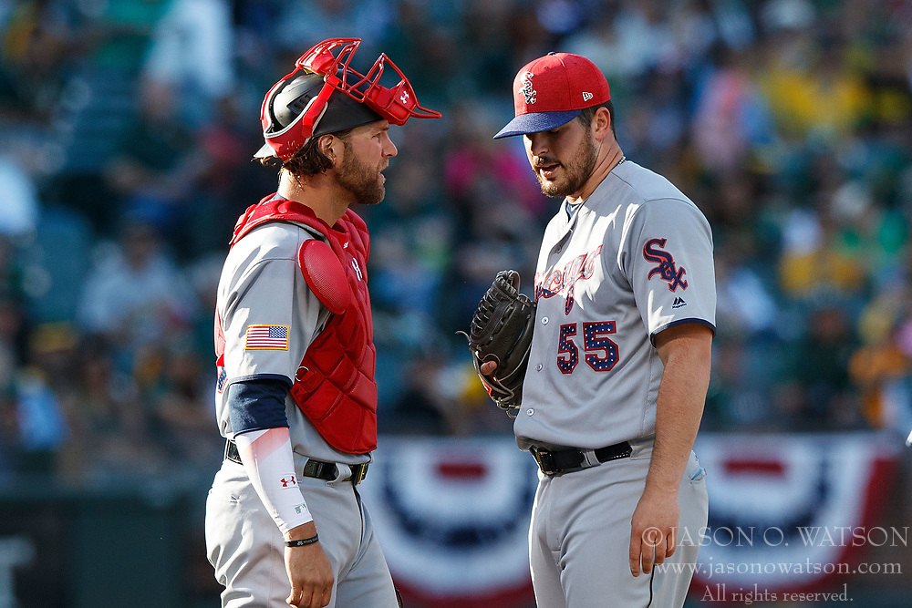 OAKLAND, CA - JULY 03:  Kevan Smith #36 of the Chicago White Sox talks to Carlos Rodon #55 during the second inning against the Oakland Athletics at the Oakland Coliseum on July 3, 2017 in Oakland, California. The Chicago White Sox defeated the Oakland Athletics 7-2. (Photo by Jason O. Watson/Getty Images) *** Local Caption *** Kevan Smith; Carlos Rodon