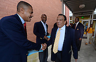 Atlanta - August 7, 2013: Mike Anderson greets former Atlanta Mayor and United Nations Ambassador Andrew Young on the first day of school at B.E.S.T Academy (Business Engineering Science Technology) on Wednesday, August 7 ,2013.  Over 80 members of the 100 Black Men of Atlanta greeted the boys and their parents as they arrived at school.  The boys were inspired by Young to become leaders in the community.  Young spoke to boys in middle school and high School.  The school is an all male school.  Today was the first day back to school for students in Atlanta.  ©2012 Johnny Crawford