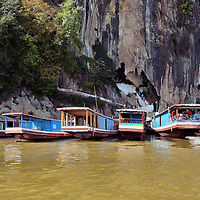 Slow Boats at Pak Ou Caves Entrance in Ban Pak Ou, Laos<br />