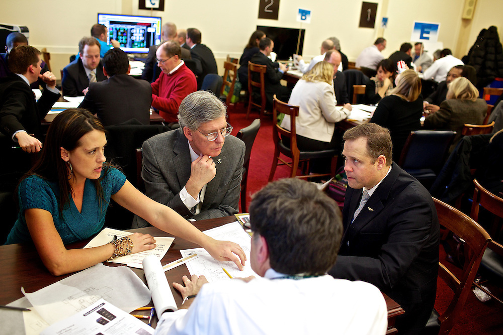 Congressman-elect Jim Bridenstine, from Oklahoma's First District, right, makes decisions about his future office, with his chief of staff Joe Kaufman, center, and Denise Leonard, CAO move coordinator, left, in the Rayburn House Office Building in Washington, DC on Nov. 30, 2012.